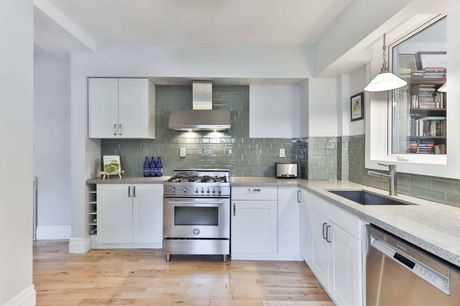 Kitchen Cabinet Refacing - Clinical clean white colored kitchen cabinet doors